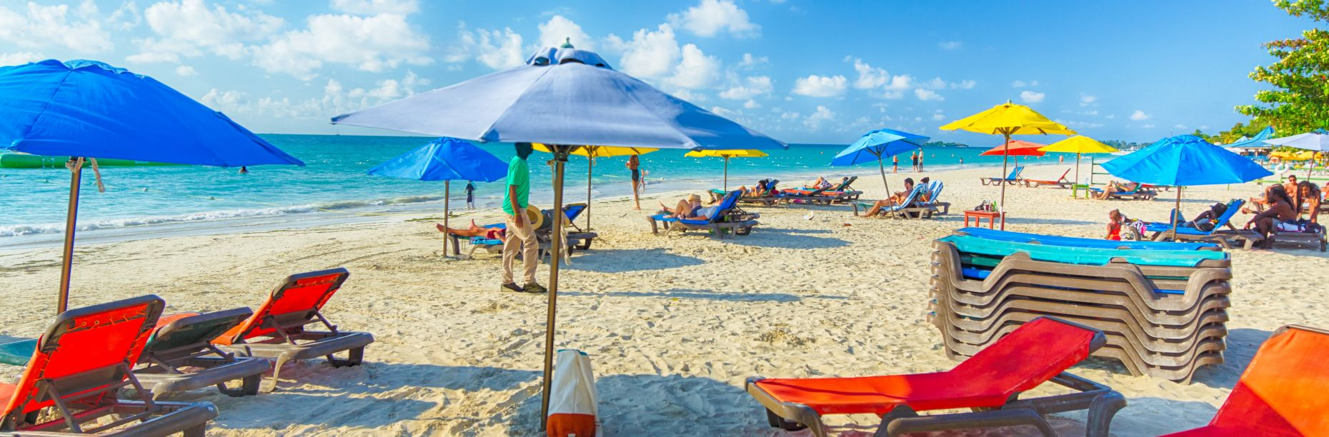 Colorful umbrellas and lounge chairs on the beach
