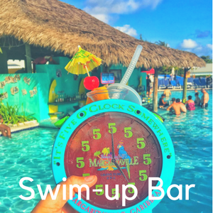 An alarm clock drink holder in front of a swim up bar