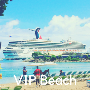 A beach with a cruise ship in the ocean