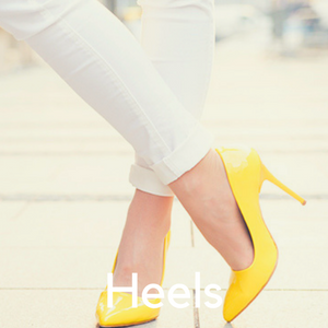 A woman in white jeans and yellow high heels