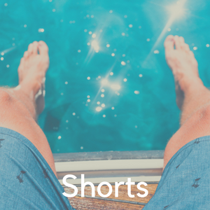 A man's legs in shorts above a pool