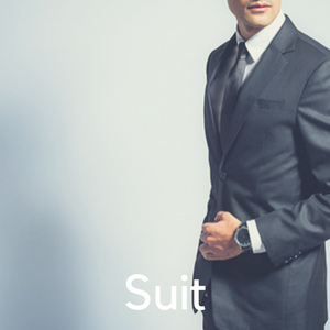 A man in a suit against a grey background