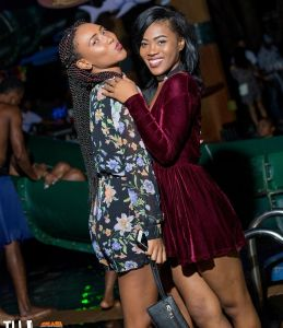 Two women pose for a photo during ladies night at the Margaritaville Caribbean nightclub